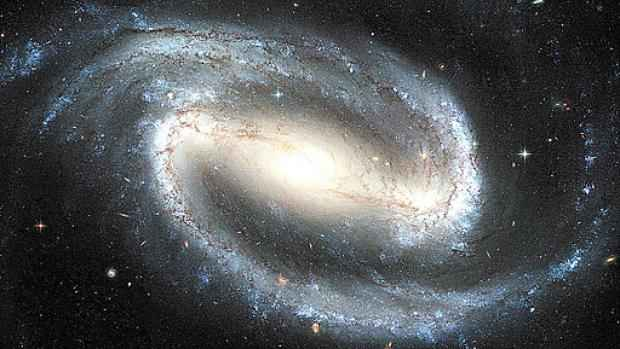 Imagem da Via Láctea, onde está localizado o Sistema Solar: segundo o novo estudo, o grupo de estrelas integra um assombroso conjunto de 100 mil galáxias