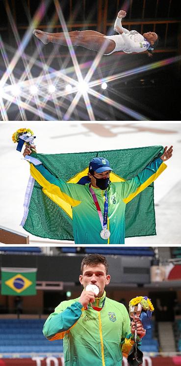 Kelvin Hoefler, medalha de prata no skate Daniel Cargnin, medalha de bronze no judô Ao som de um arranjo instrumental de um hit do momento no Brasil, a ginasta Rebeca Andrade consegue a segunda melhor pontuação geral e se classifica para três finais nas Olimpíadas de Tóquio. Torcida brasileira festeja a conquista das primeiras medalhas: o skatista Kelvin Hoefler levou prata; e o judoca Daniel Cargnin garantiu bronze. No futebol, a Seleção masculina volta a mostrar dificuldade diante de um rival africano e fica no empate sem gols com a Costa do Marfim. Mulheres do vôlei não vacilam e estreiam com vitória contundente sobre a Coreia do Sul.   (Lionel Bonaventure/AFP - Jonne Roriz/COB - Gaspar Nóbrega/COB)
